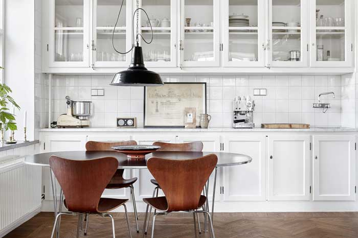 Jacobsen chairs in a white kitchen