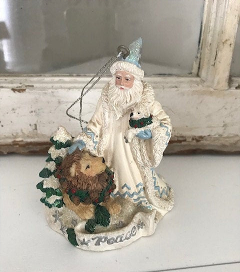 Santa ornament white robe blue mittens hat lion puppy