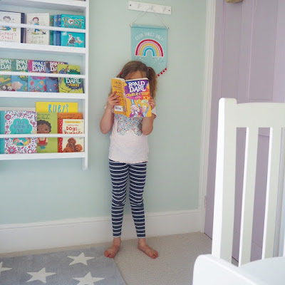 Ellie by her greenway bookshelf from GLTC, it's great for displaying books your favourite books and easy for children to find them too