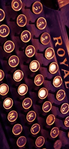 Vintage dark brown typewriter wallpaper