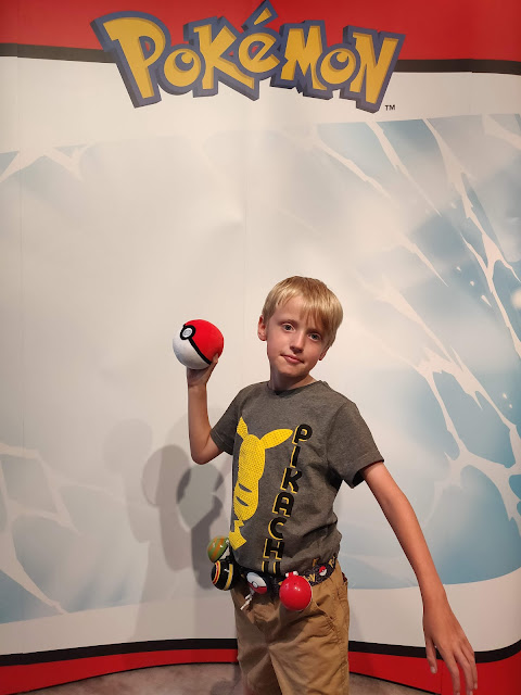 madmumof7's son with Pokemon Clip N Go Belt and Pop Action Poke Ball