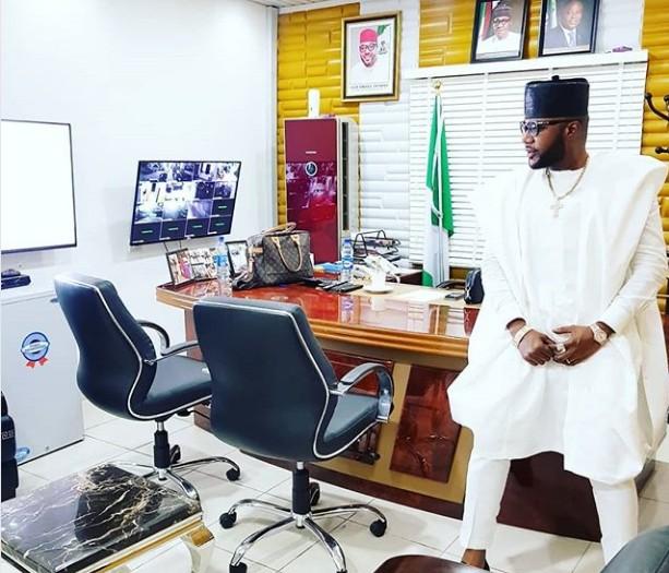 E Money Front His Multimillion Naira Office