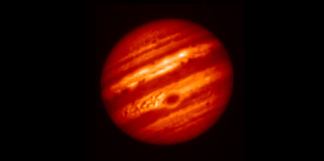 Image of Jupiter taken on May 18, 2017, one day before the Juno spacecraft's sixth close approach to Jupiter, taken with a filter centered at 8.8 microns that is sensitive to Jupiter's tropospheric temperatures and the thickness of a cloud near the condensation level of ammonia gas. The Great Red Spot appears distinctively at the lower center of the planet as a cold region with a thick cloud layer. It is surrounded by a warm and relatively clear periphery. To its northwest is a turbulent and chaotic region of gas with bands of alternative warm, dry and cold, moist gas. Many other features are also present. This image shows the detailed atmospheric structure of the Great Red Spot and its surroundings that the Juno mission will encounter on its seventh closest approach to Jupiter on July 11, 2017. A video created from a series of observations with same settings in January 14, 2017 shows variation of features on Jupiter. The instrument used to take these images is Subaru Telescope's facility instrument COoled Mid-Infrared Camera / Spectrometer (COMICS). (Credit: NAOJ and JPL)