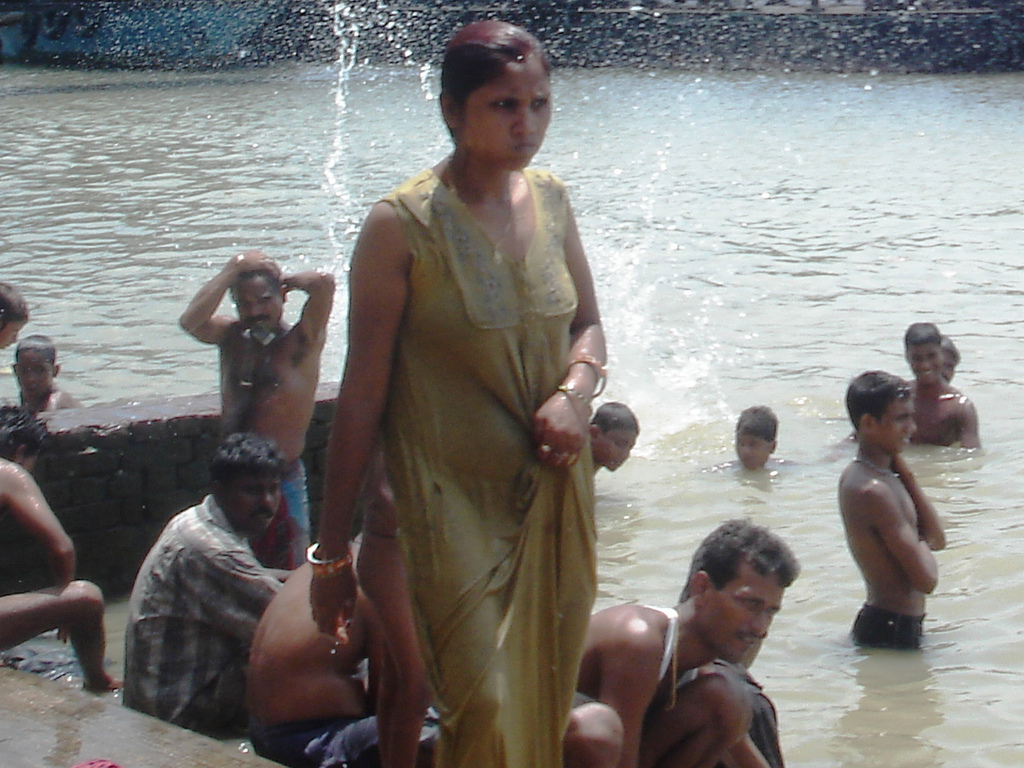 Naked women bathing in river