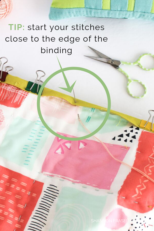 Tip: start your stitches close to the edge of your binding | Big Stitch Hand Quilted Binding | Quilt Binding Tutorial Part 3 | Shannon Fraser Designs #bigstitchquilting #handquilted