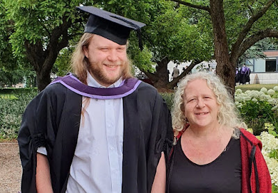 My 2nd son Jake graduation photo with me beside