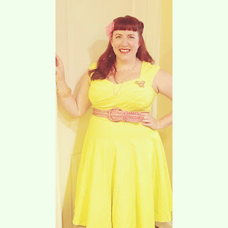 Bridget Eileen plus size pagan pinup poet and blogger in yellow swing dress