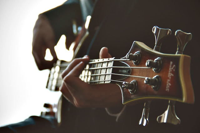 A person playing an electric guitar