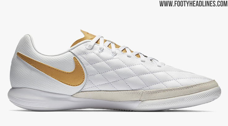 cbbfc069f49090 The white and golden Nike Ronaldinho indoor and turf boots draw inspiration  from Ronaldinho s classic signature cleats. They are all-white with golden  logos ...