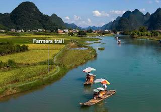 Farmers trail near Yulong river.