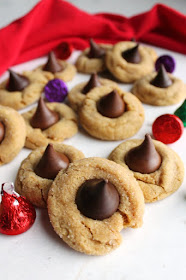 A chewier version of the classic blossom cookie. A soft peanut butter cookie hugs a chocolate candy for a piece of holiday heaven! It just wouldn't be Christmas without them!