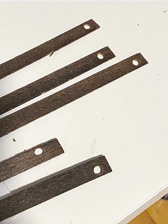 holes in wooden slats