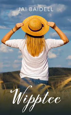 Farm girl with straw hat looking at landscape