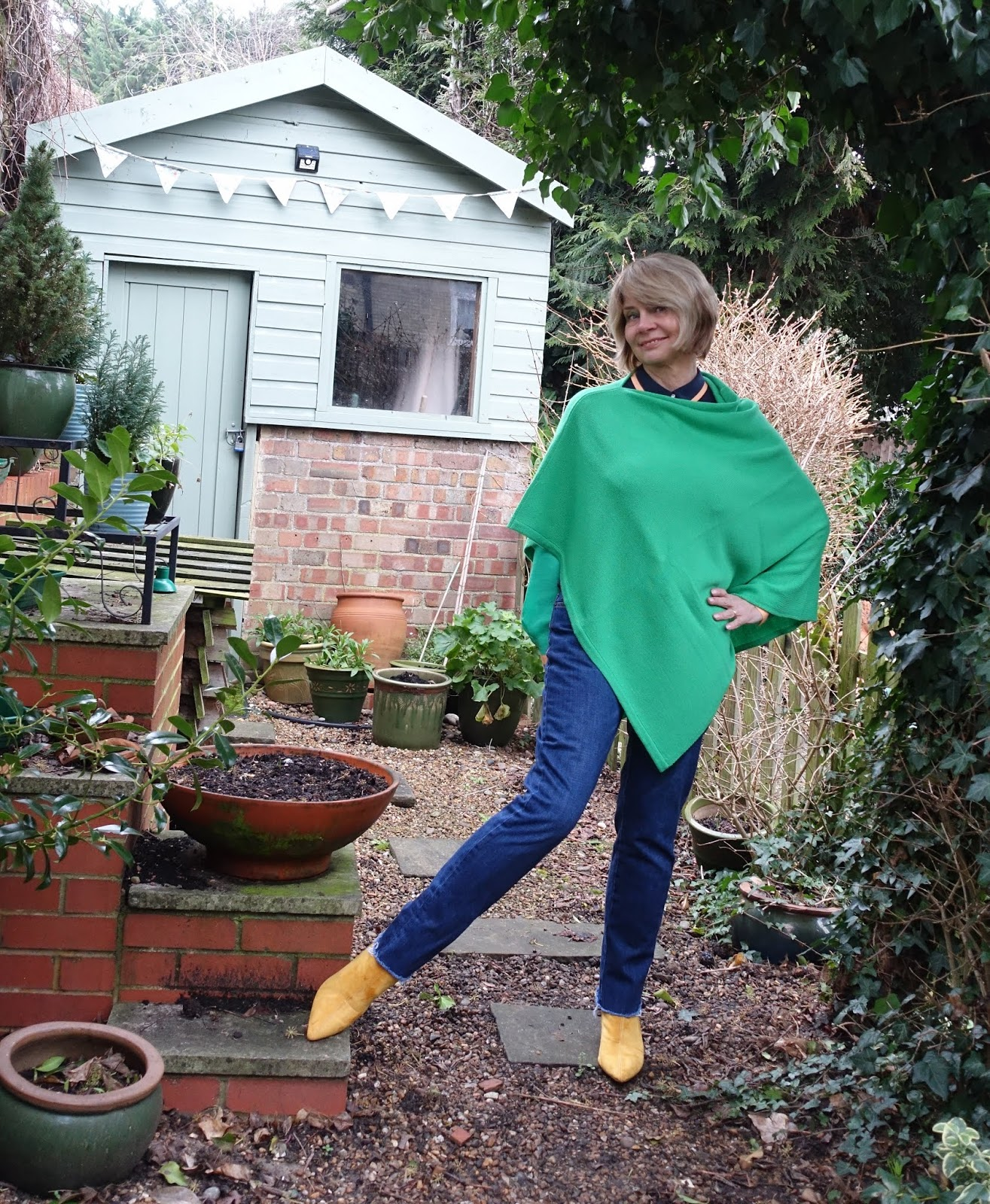 Over 50s blogger Gail Hanlon from Is This Mutton in green City poncho from Kettlewell and Hush jeans