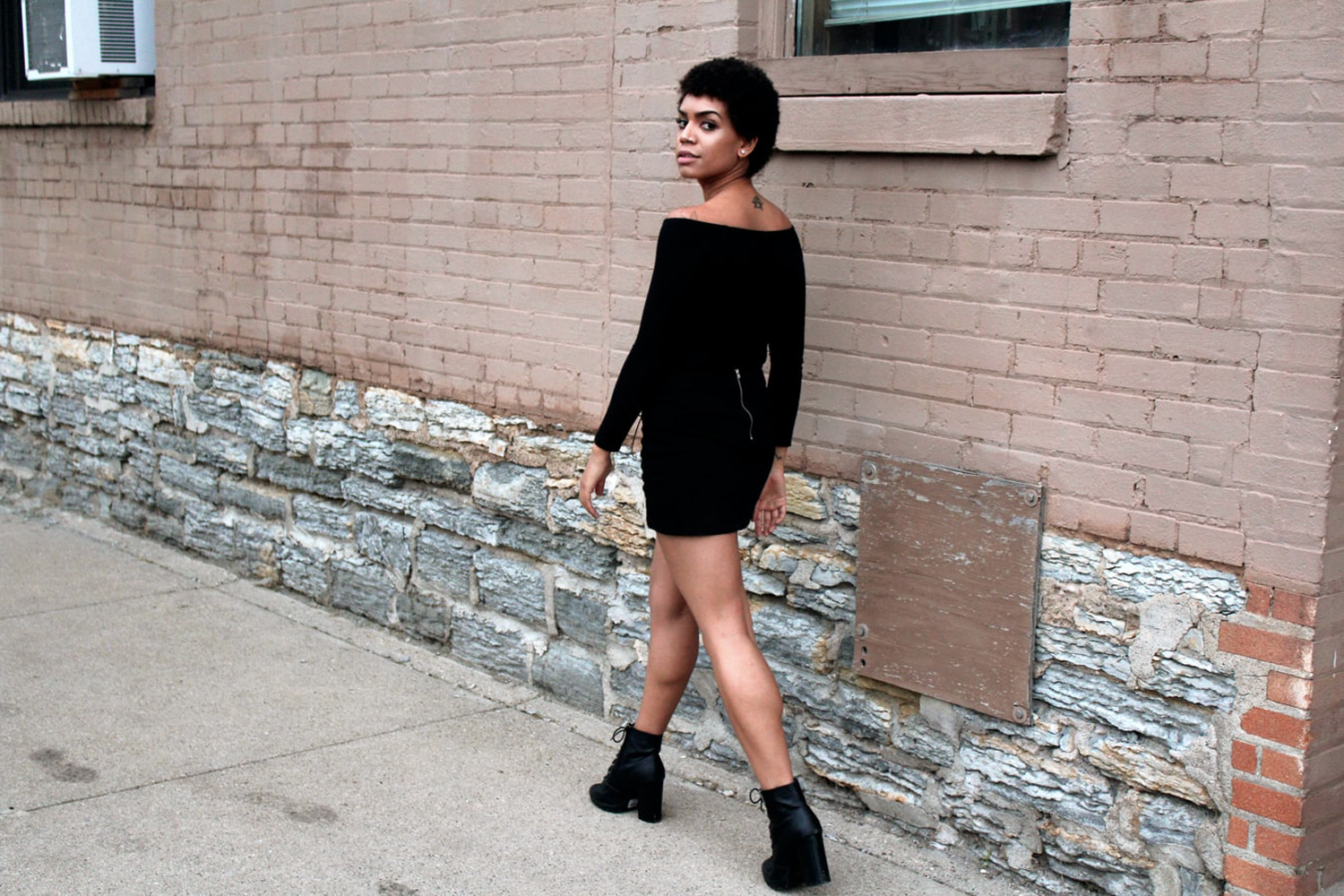 woman is wearing beautiful, all-black outfit