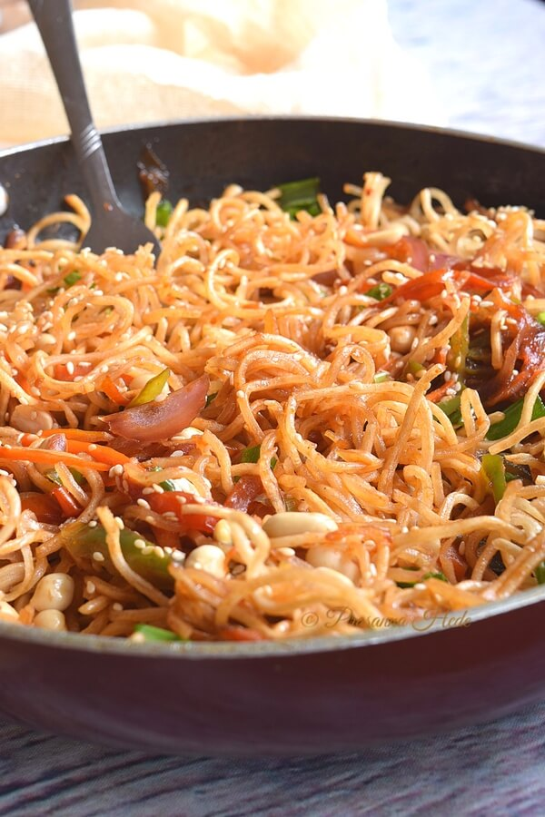Delicious chinese noodles - street food with sesame seeds,peanuts,noodles,and vegetables tossed in lovely sauces.
