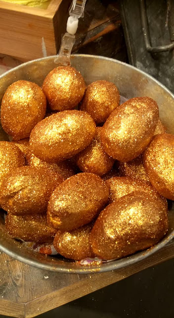 A bag full of golden egg bath bombs.