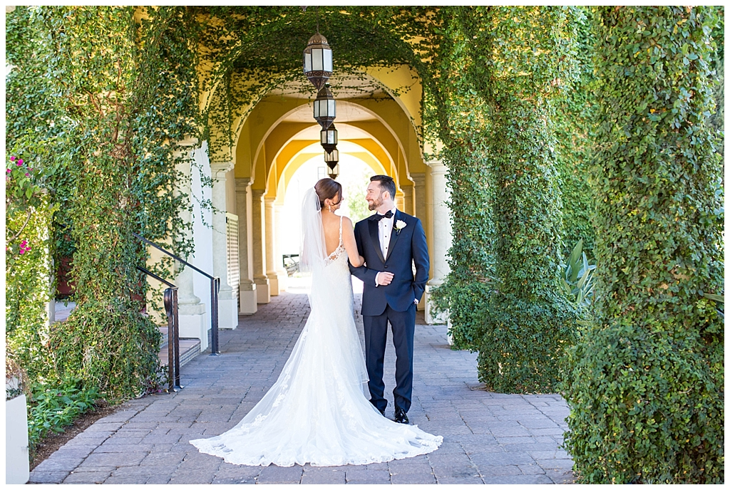 Elegant bride and groom portrait with green ivy walls at Omni Montelucia