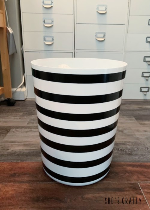 6 essentials to have in any craft room- cute, black and white striped trash can