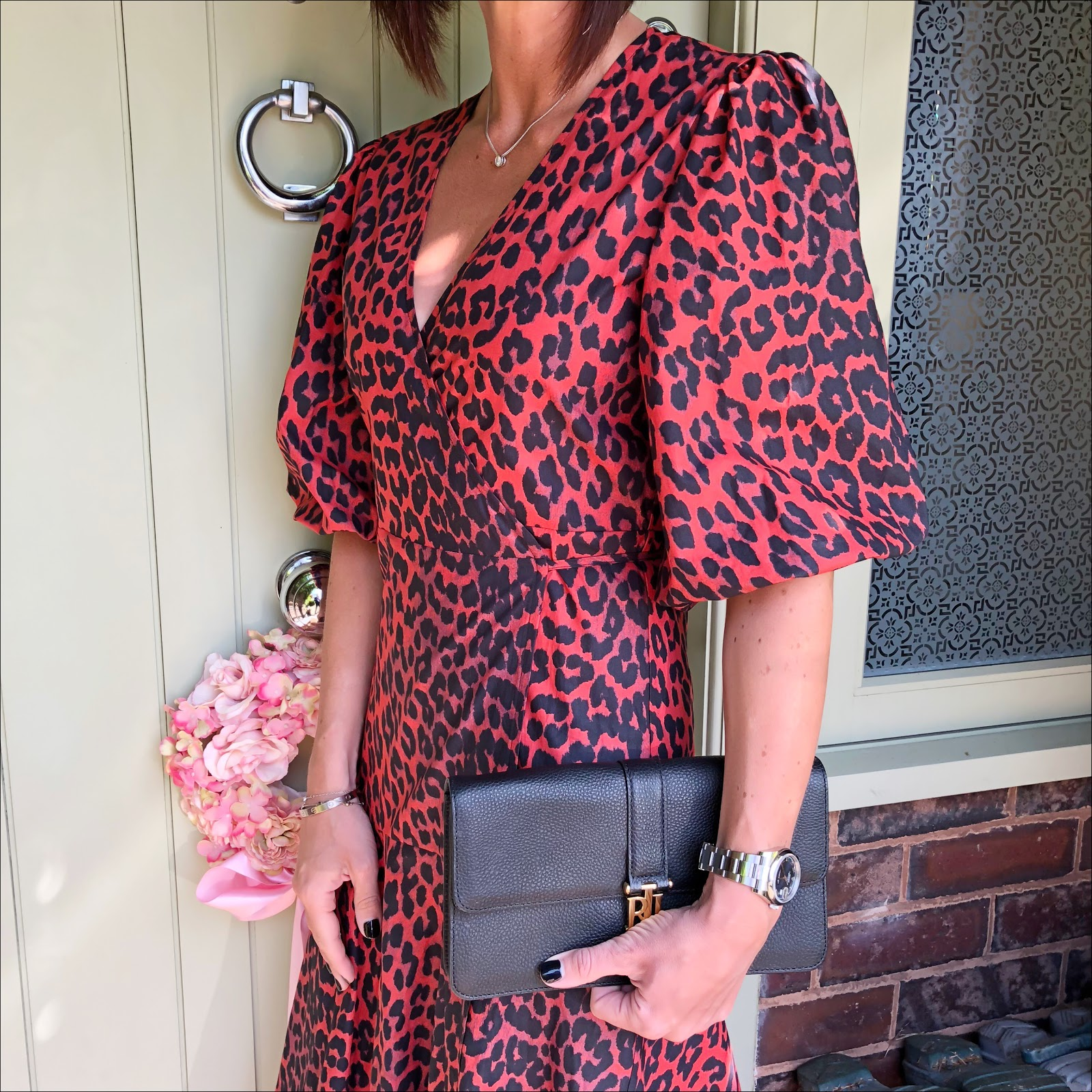 my midlife fashion, ganni bijou leopard print cotton poplin wrap dress, marks and spencer large dot black fascinator, and other stories mid court heel strap sandals, lauren ralph lauren clutch