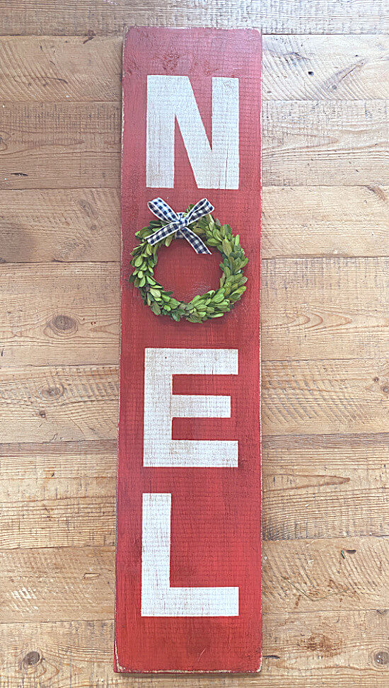 Noel sign with a wreath