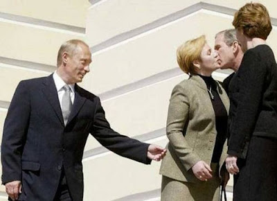 George W. Bush kisses Lyudmila Putin