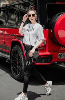 Hoa hậu Huỳnh Vy phối đồ thể thao cùng túi hiệu