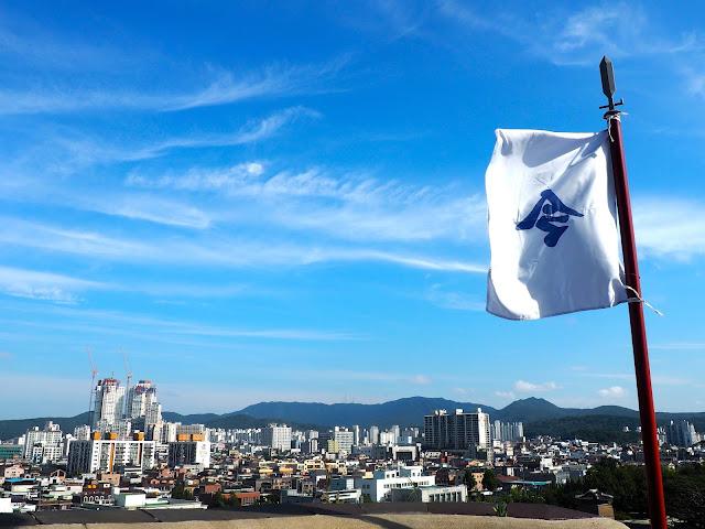 White flag and the view of Suwon from Hwaseong fortress walls around Suwon, Gyeonggi-do, South Korea