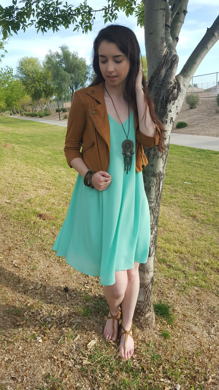 flowy shift dress with a suede jacket and boho accessories