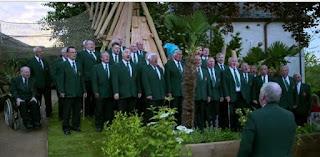 A Local choir sings in the garden