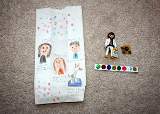 "Tessa included smiley face stickers, a wooden sunflower cutout (to represent Sunny the Sunflower) and a Playmobil doctor as clues in her Discovering Family bag. She chose ""friendly and helpful"" from the Girl Scout Law as the value that is important to our family because ""being friendly and helpful shows that our family cares about people."""