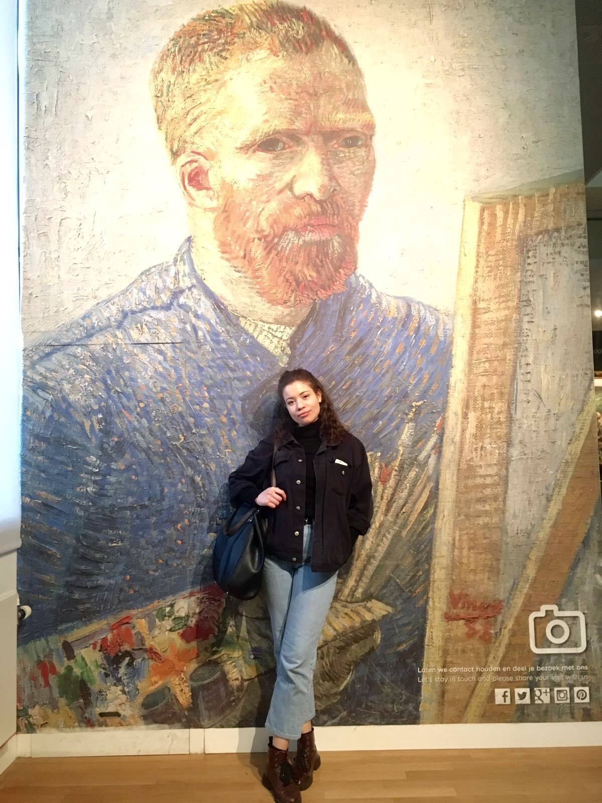 Eboni posing in front of a huge Van Gough portrait in the Van Gough museum, Amsterdam.