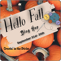 hello fall sign in a pumpkin patch