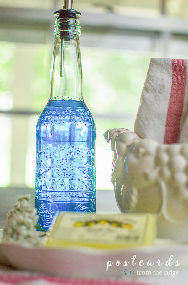 pretty glass bottle with dispenser spout