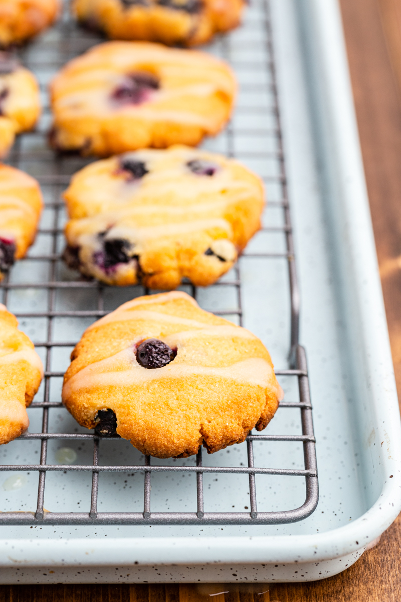 Closeup photo of Keto Blueberry Cheesecake Cookies on a cooling rack.