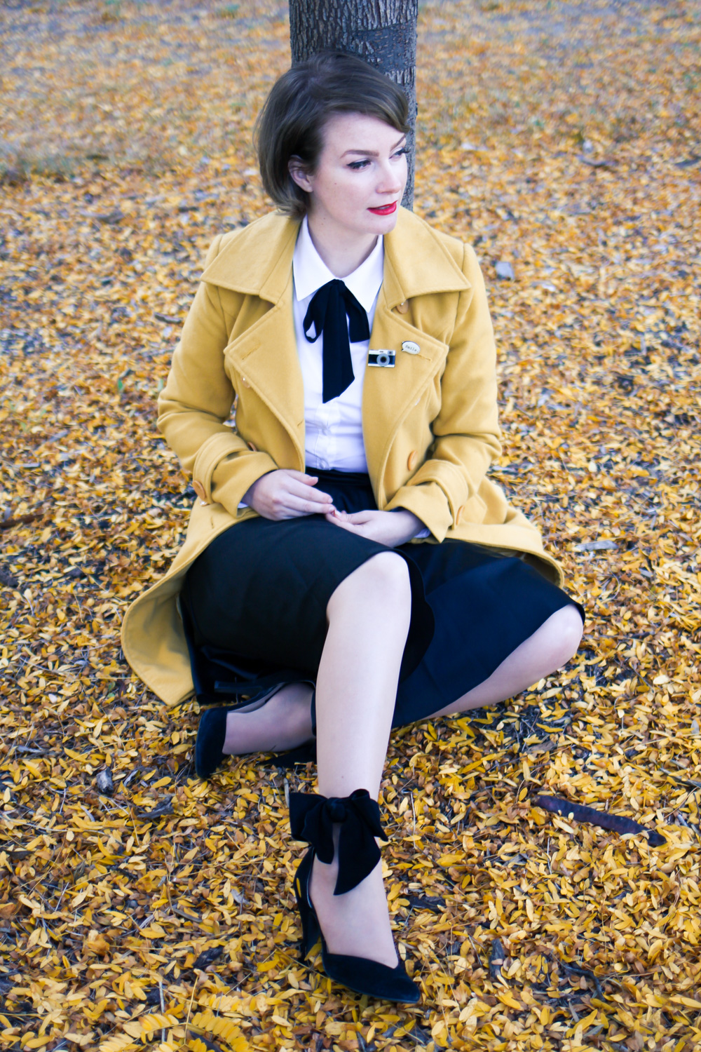 @findingfemme wears mustard coat with bok bok b'gerk brooch and neck tie.
