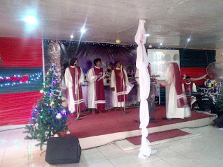 Christmas carol ministration in progress