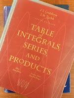 Table of Integrals, Series, and Products, by Gradshteyn and Ryzhik, superimposedo n Intermediate Physics for Medicine and Biology.