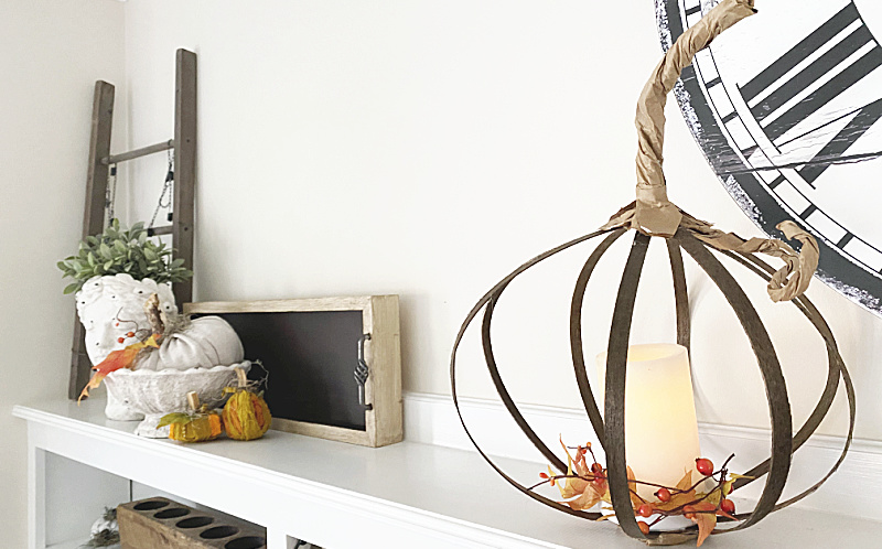 pumpkin mantel with pumpkin candle