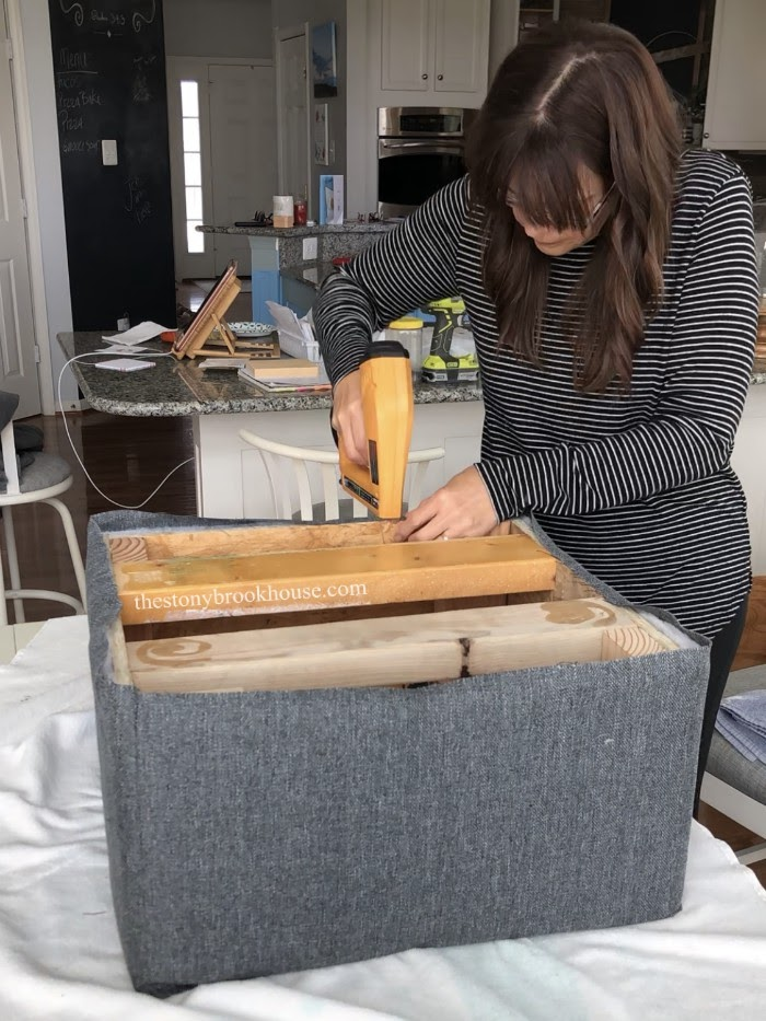 stapling fabric to ottoman base