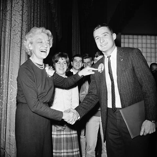 Image Attribute: U.S. Sen. Margaret Chase Smith, left, laughs and shakes hands with a supporter of Barry Goldwater, one of her Republican rivals for the presidential nomination, in 1964. / Source: AP Photo