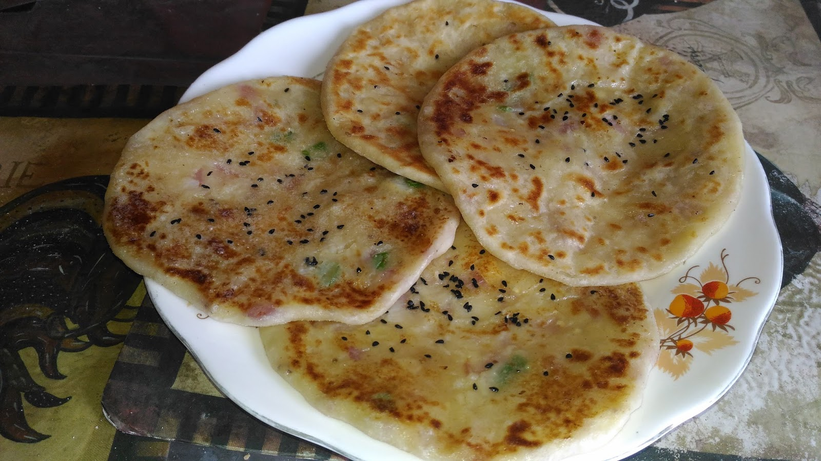 Indian food recipes indian recipes desi food desi recipes place the rolled out kulcha on the tawa cook on one side for two mins and then flip over till brown apply butter and serve it forumfinder Choice Image