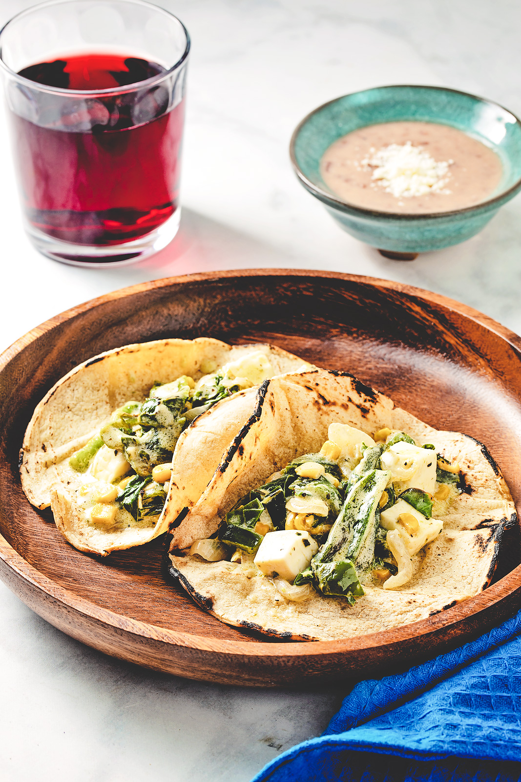 Rajas con crema tacos with wine and refried beans.