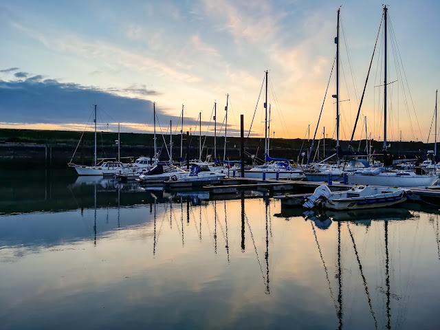 Phone photo of Maryport Marina after sunset