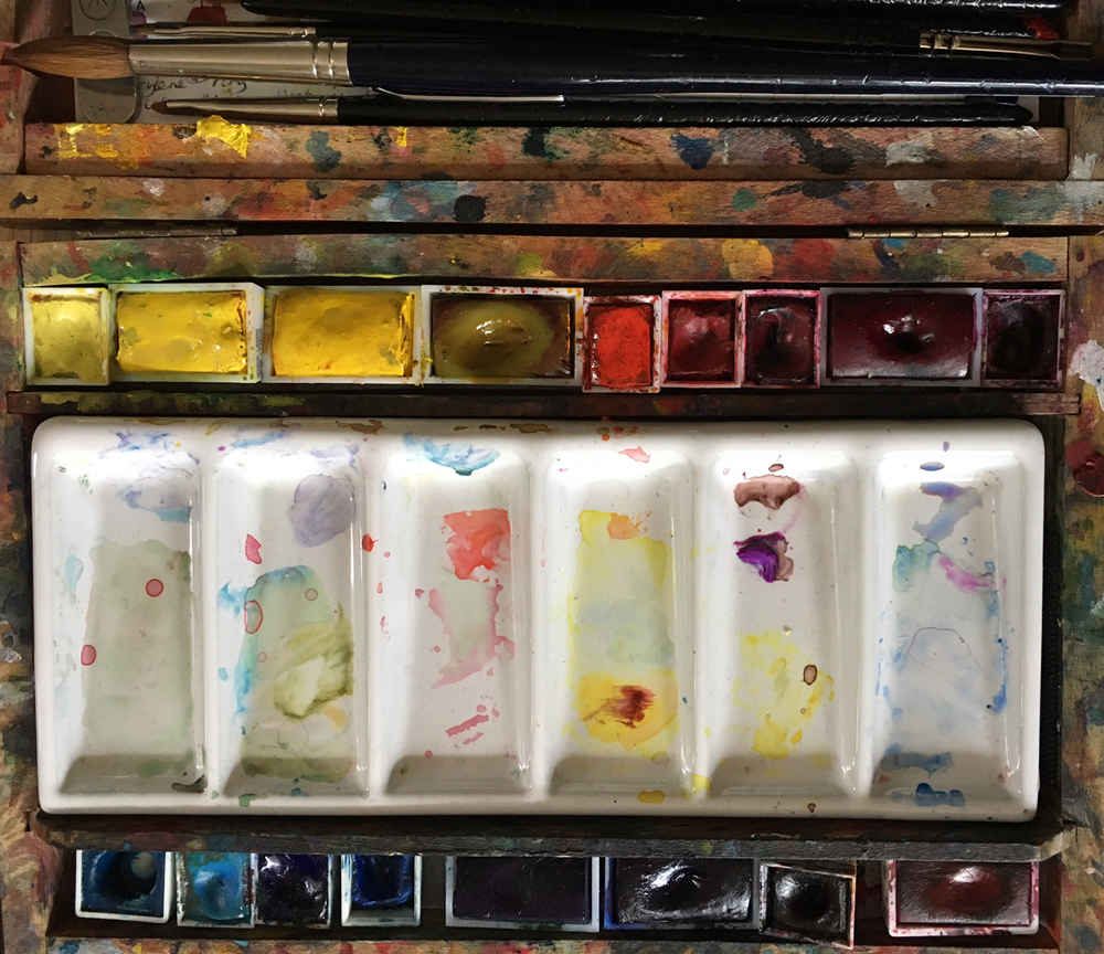 Paintbox with pans of watercolour and ceramic palette