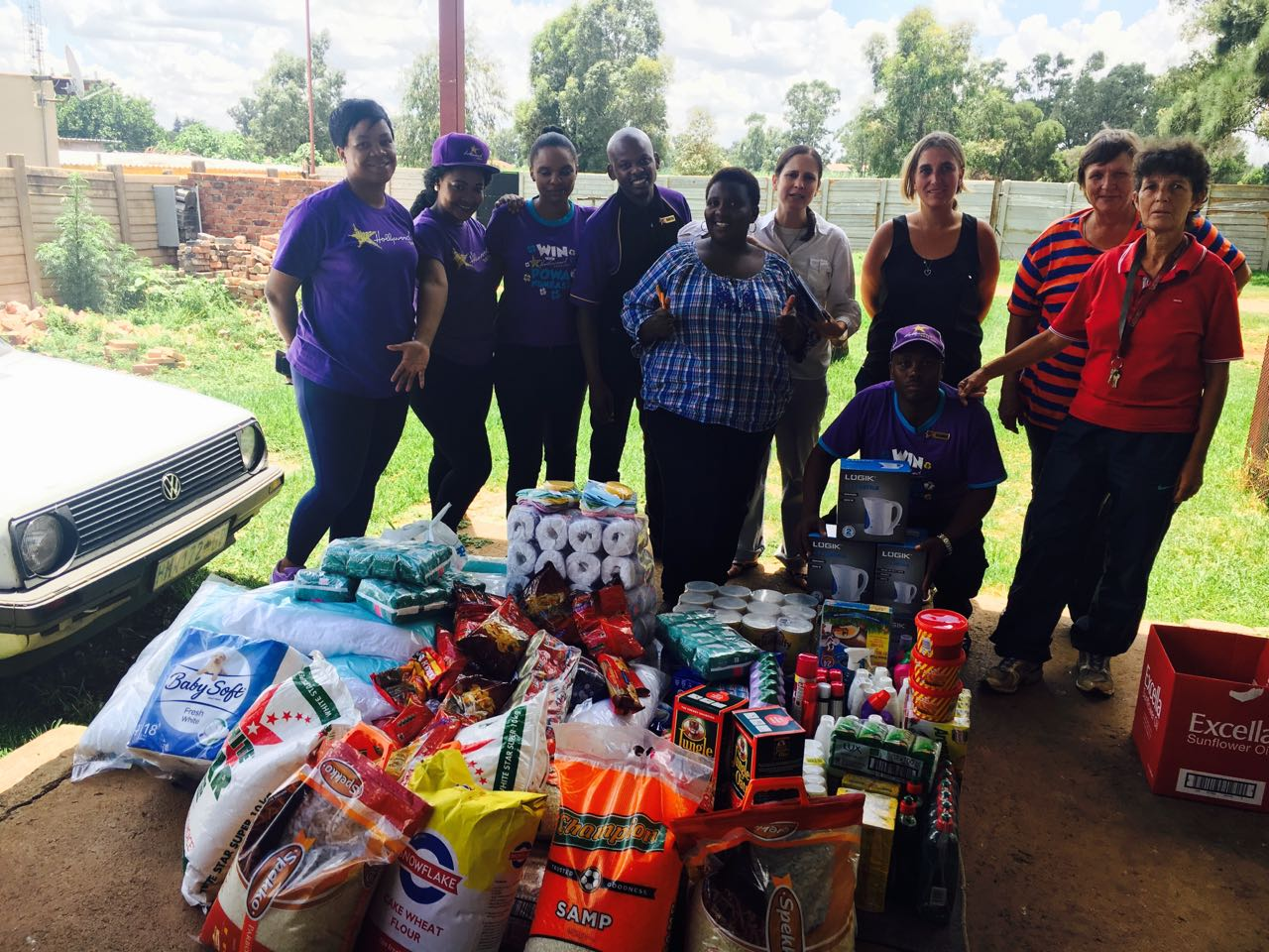 Siyabonga Africa saff members are thankful for a donation from Hollywoodbets Brakpan