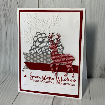 Christmas card with snowflakes, banners and a deer