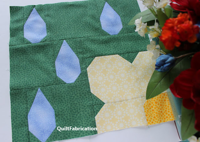 blue raindrops hitting a yellow flower quilt block