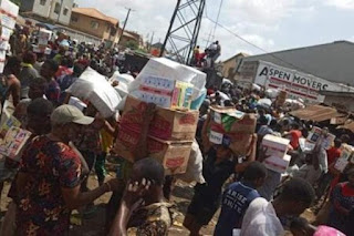 Photo - ( Angry Nigeria Citizens Loot COVID-19 Palliatives Warehouses )