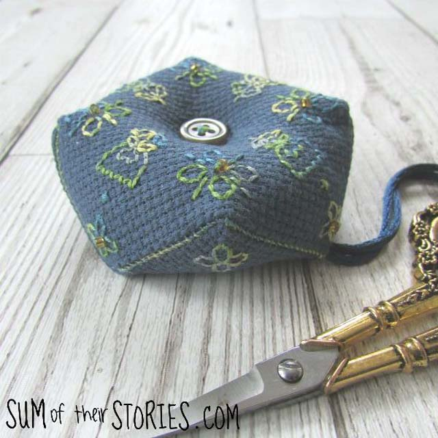 Learn how to make a mini biscornu pincushion. Tutorial by Sum of their Stories.